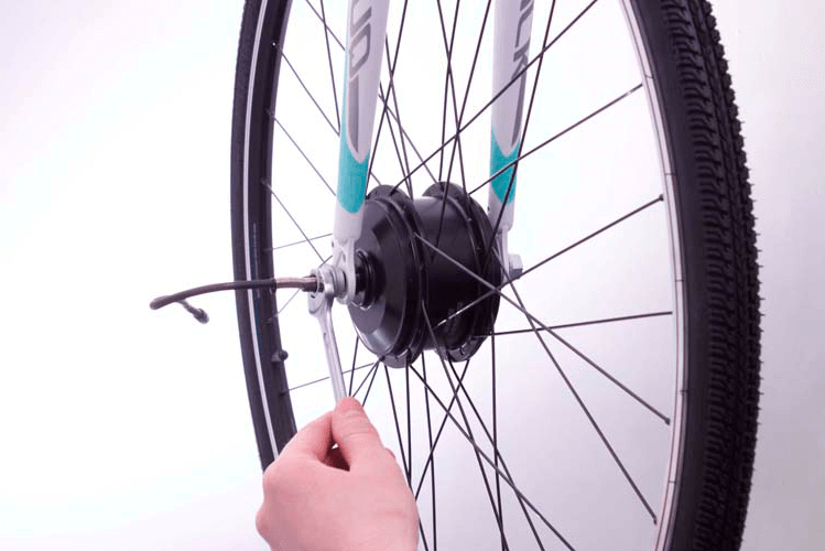 Remove the front wheel from your bike and replace with C1 motor wheel
