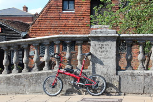 Customer's Bike Friday folding bicycle fitted with Cytronex C1 electric bike conversion kit, enjoying the sun in historic Winchester